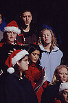 YOUNG CAROLERS ENTERTAIN ON STREET IN COLORADO
