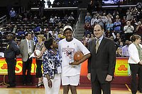 March 14, 2010.  Nnemkadi Ogwumike receives the trophy for the most valuable play in the 2010 Pac-10 Tournament.  The Stanford Cardinal defeated the UCLA Bruins to win the tournament.