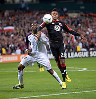 Lionard Pajoy (26) of D.C. United takes control of the ball in front of Kwame Watson-Siriboe (3) of Real Salt Lake during the game at RFK Stadium in Washington, DC.  D.C. United defeated Real Salt Lake, 1-0.