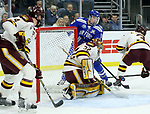 SIOUX FALLS, SD - MARCH 24: Kyle Haak #16 from Air Force tries a wrap around against goalie Hunter Shepard #32 for Minnesota Duluth during their game at the 2018 West Region Men's NCAA DI Hockey Tournament at the Denny Sanford Premier Center in Sioux Falls, SD. (Photo by Dave Eggen/Inertia)