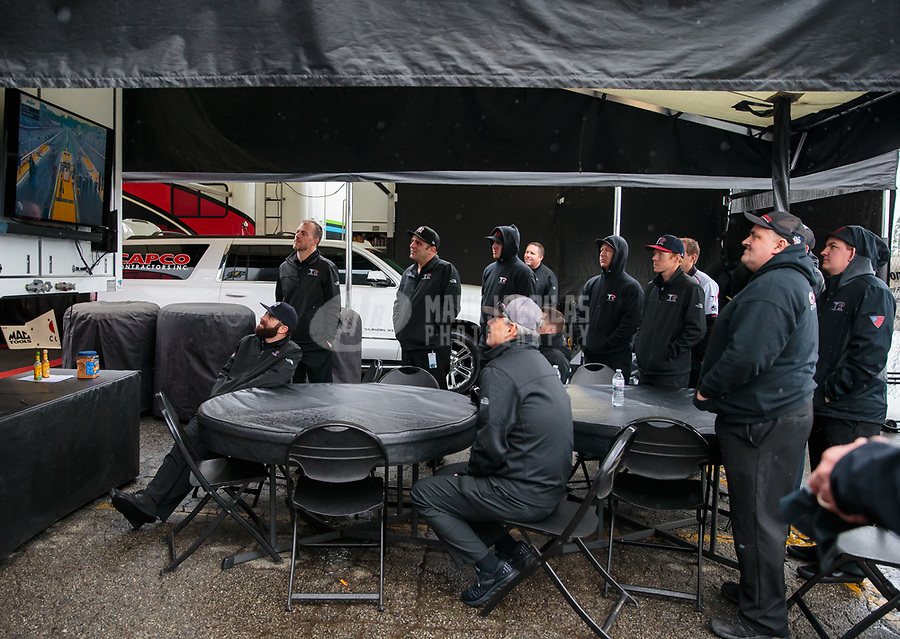 Feb 10, 2019; Pomona, CA, USA; Crew members for NHRA top fuel driver Steve Torrence during the Winternationals at Auto Club Raceway at Pomona. Mandatory Credit: Mark J. Rebilas-USA TODAY Sports