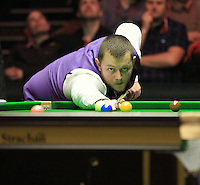 Mark Allen plays a long shot on the yellow during the Dafabet Masters Quarter Final 1 match between Mark Allen and Barry Hawkins at Alexandra Palace, London, England on 14 January 2016. Photo by Liam Smith / PRiME Media Images