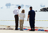 United States President Barack Obama (L) tours the beach at Port Fourchon with Admiral Thad Allen (R) and Parish President Charlotte Randolph (C), Friday, May 28, 2010 in Port Fourchon, Louisiana. The oil spill resulting from the Deepwater Horizon disaster now officially ranks as the worst in U.S. history.  .Credit: Win McNamee - Pool via CNP