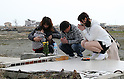 March 11, 2016, Tokyo, Japan - Relatives of tsunami victims offer prayers on the tsunami wrecked land at Namie in Fukushima prefecture near the crippled TEPCO's nuclear plant on Friday, March 11, 2016 on the fifth anniversary of the Great East Japan Earthquake and Tsunami.  (Photo by Yoshio Tsunoda/AFLO)