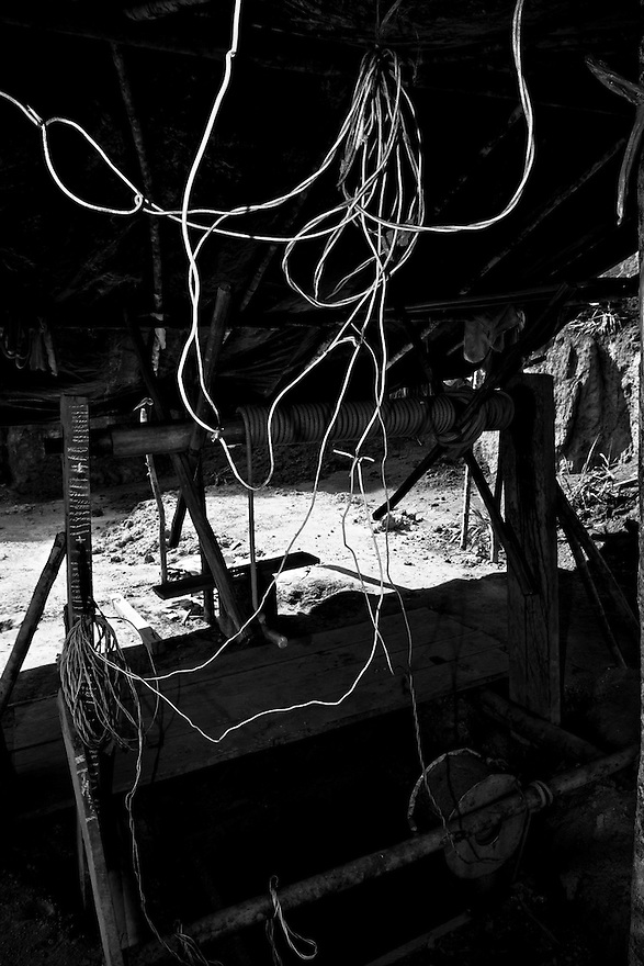 Precarious and dangerous wiring used in underground gold mining, where the metal is extracted through tunnels. Agua Branca gold mining village, Amazon rain forest, Para State, Brazil.
