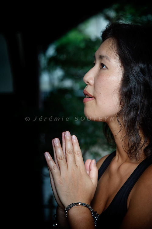 Tokyo, September 4th 2010 - Japanese composer Misato Mochizuki in a shinto temple near her place in Shirokanedai district, Tokyo. Misato Mochizuki has a christian background but is getting more and more interested in shintoism for its tolerance.