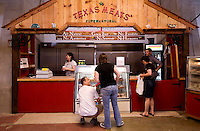 Scott Garelick (cq, left middle) smiles at his wife Km Garelick (cq) when picking meat from Rehoboth Ranch selling at the new Texas Meats booth at the Dallas Farmers Market in Dallas, Texas, Saturday, April 26, 2009. Tomato and pepper season is just around the corner as greens near the end of their season. ..MATT NAGER/ SPECIAL CONTRIBUTOR
