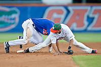 June 12, 2010:    Miami Infielder Stephen Perez (4) looses the ball while trying to tag Florida Outfielder Matt den Dekker (17) during game two of NCAA Gainesville Super Regional action between the University of Florida Gators and Miami Hurricanes at Alfred A. McKethan Stadium on the campus of University of Florida in Gainesville.   Florida defeated Miami in 10 innings 4-3 to advance to the College World Series in Omaha, Nebraska...........