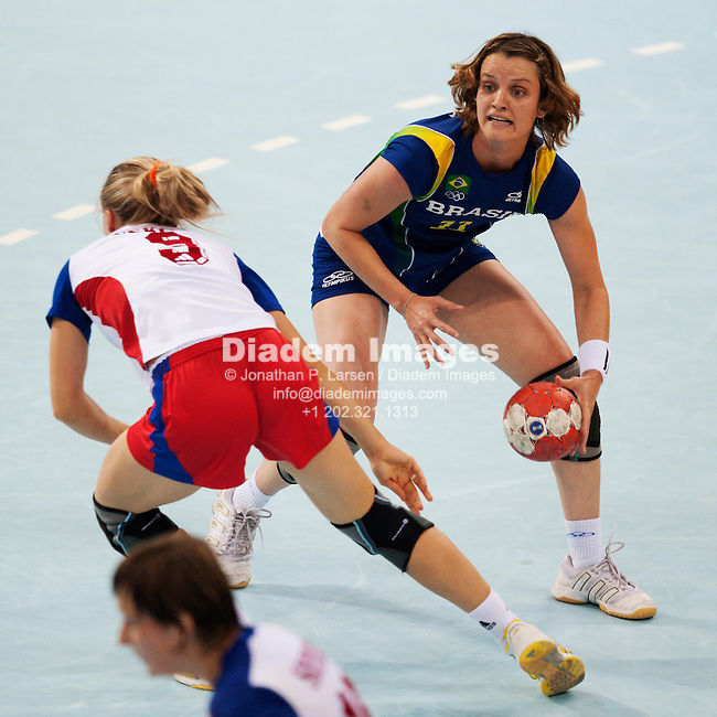 BEIJING - AUGUST 12:  Viviane Jacques of Brazil looks to pass the ball during a Group B handball match against Russia at the Summer Olympic Games on August 12, 2008 in Beijing, China.  Editorial use only.  Commercial use prohibited.  (Photograph by Jonathan Paul Larsen)