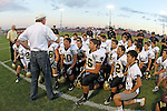 Lawndale, CA 10/01/10 - Retired Principal Kelly Johnson addresses the Peninsula Panthers before the start of the game against Lawndale.