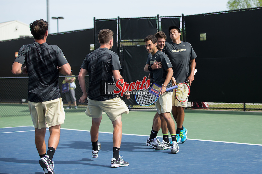 Noah Rubin (second from right) and doubles partner Jon Ho (right) are congratulated by their teammates after clinching the doubles point against the North Carolina Tar Heels at the Wake Forest Tennis Center on April 11, 2015 in Winston-Salem, North Carolina.  The Demon Deacons defeated the Tar Heels 4-3.    (Brian Westerholt/Sports On Film)