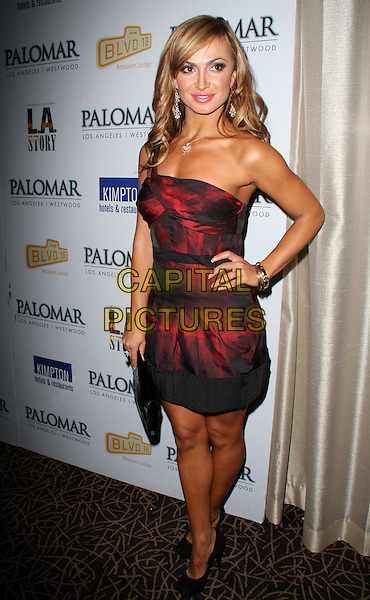 "KARINA SMIRNOFF.""A Night For Change"" An Alternative Intervention Models (A.I.M.) Benefit held at BLVD 16 Hotel Palomar, Westwood, California, USA..December 8th, 2008.full length red strapless dress black sheer one shoulder clutch bag hand on hip.CAP/ADM/KB.©Kevan Brooks/AdMedia/Capital Pictures."