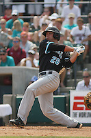 The Coastal Carolina University Chanticleers right fielder Daniel Bowman #26 at bat during the 2nd and deciding game of the NCAA Super Regional vs. the University of South Carolina Gamecocks on June 13, 2010 at BB&T Coastal Field in Myrtle Beach, SC. Daniel hit a home run with this swing.  The Gamecocks defeated Coastal Carolina 10-9 to advance to the 2010 NCAA College World Series in Omaha, Nebraska. Photo By Robert Gurganus/Four Seam Images