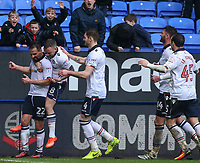 Bolton Wanderers' Filipe Morais is mobbed by teammates after he scored the winning goal<br /> <br /> Photographer Alex Dodd/CameraSport<br /> <br /> The EFL Sky Bet League One - Bolton Wanderers v Northampton Town - Saturday 18th March 2017 - Macron Stadium - Bolton<br /> <br /> World Copyright &copy; 2017 CameraSport. All rights reserved. 43 Linden Ave. Countesthorpe. Leicester. England. LE8 5PG - Tel: +44 (0) 116 277 4147 - admin@camerasport.com - www.camerasport.com