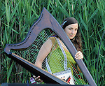 Harpist, Elizabeth Clark-Jerez of Mamalama, performing at Saugerties Sunset Concert at Glasco Mini Park, NY on Friday, July 1, 2011. Photo © Jim Peppler 2011.