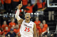 Virginia forward Akil Mitchell (25) reacts to a play during the game against NC State Saturday in Charlottesville, VA. Virginia defeated NC State 58-55.