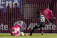 Sporting Kansas City goalkeeper Jimmy Nielsen (1) denies Raymon Gaddis (28) of the Philadelphia Union. Sporting Kansas City defeated the Philadelphia Union 2-1 during a Major League Soccer (MLS) match at PPL Park in Chester, PA, on October 26, 2013.