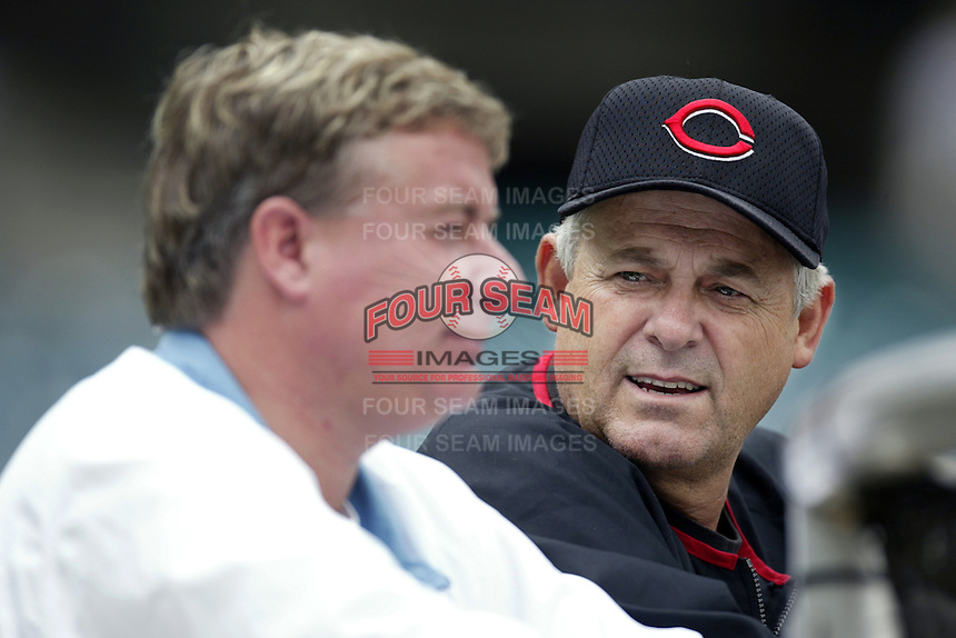 Cincinnati Reds Manager Bob Boone talks with the Reds General Manager Jim Bowden before a 2002 MLB season game against the Los Angeles Angels at Angel Stadium, in Anaheim, California. (Larry Goren/Four Seam Images)