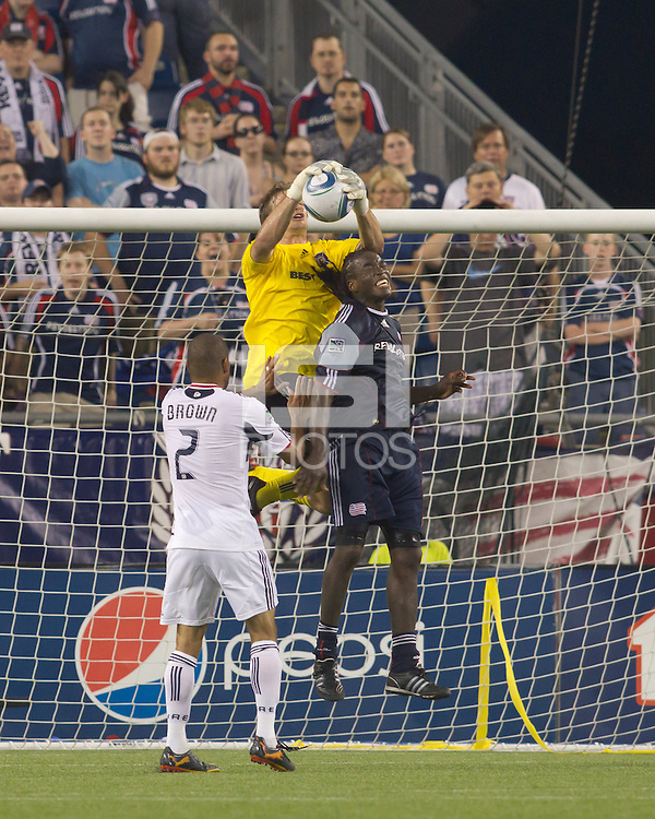 New England Revolution midfielder Shalrie Joseph (21) and Chicago Fire goalkeeper Andrew Dykstra (40) battle for a high ball. The Chicago Fire defeated the New England Revolution, 1-0, at Gillette Stadium on June 27, 2010.