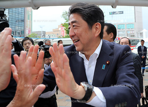 June 22 2016, Koriyama, Japan - Japanese Prime Minister and ruling Liberal Democratic Party (LDP) president Shinzo Abe shakes hands with his party supporters after he delivered a campaign speech for his party's candidate Mitsuhide Iwaki during the Upper House election campaign in Koriyama in Fukushima prefecture on Wednesnday, June 22, 2016 sonce July 10 Upper House election started in Japan.   (Photo by Yoshio Tsunoda/AFLO) LWX -ytd-