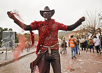 """Feb. 27, 2012 - Galaxidi, Greece: Reveller with glasses to protect his eyes and t-shirt with the name of the warrior ancient city """"Sparta"""" throws red colour. Every year revellers celebrate the """"clean Monday"""" by throwing flour and colored podwer. This day marks the end of the carnival seazon and the start of the 40-day period of the Orthodox Easter (Maro Kouri/ Polaris) .A Galaxidi, in Grecia, si è svolta la battaglia della farina, Clean Monday o Pure Monday, che segna la fine del carnevale..ITALY ONLY"""