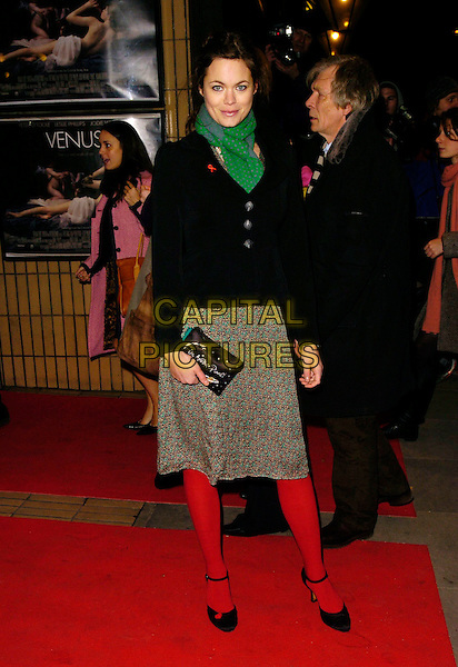 """JASMINE GUINESS.The """"Venus"""" UK premiere, Chelsea Cinema,.London, England, 22nd January 2007..full length red tights green scarf black cardigan skirt clutch bag black shoes.CAP/CAN.©Can Nguyen/Capital Pictures"""