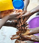 Children wash their hands before a meal in the Mary Morris Orphanage, run by the United Methodist Church in Kamina, Democratic Republic of the Congo.