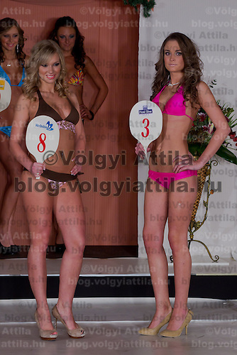 Evelin Sajtos (L) and Fanni Papai (R) participate the Miss Hungary beauty contest held in Budapest, Hungary on December 29, 2011. ATTILA VOLGYI