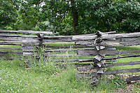A typical rail fence of the era is used for corrals at Missouri Town 1855. This old Missouri town is located on the east side of Lake Jacomo in Fleming Park in Blue Springs, MO. Missouri Town 1855 is a collection of original mid-19th century structures that were relocated from several Missouri counties to represent a typical 1850's farming community.