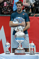 MELBOURNE, AUSTRALIA - JANUARY 12: The runner-up JUAN MARTIN DEL POTRO (ARG)  stands behind the winner's trophy at the 2013 AAMI Classic event at the Kooyong Lawn Tennis Club in Melbourne, Australia. (Photo Sydney Low)