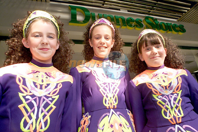 Danielle Gillispie, Newfield, Nicola Bannon, Moneymore and Leanne Flood, Newfield from the Sinead Boylan School of Irish Dancing who raised money for Telethon by dancing outside Dunnes Stores in the town centre..Picture Paul Mohan Newsfile