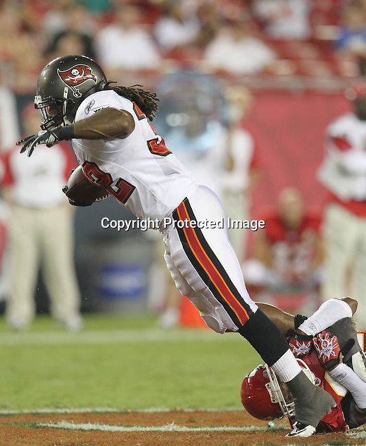 Tampa Bay Buccaneer running back Kareem Huggins is finally brought down after gaining a first down for the Buccaneers against the Kansas City Chiefs. The Buccaneers defeated the Chiefs 20-15 during an NFL preseason game Saturday, Aug. 21, 2010 in Tampa,Fla. (AP Photo/Margaret Bowles).