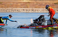 Nov. 22, 2008; Chandler, AZ, USA; A rescue diver splashes water onto a header fire on the boat of IHBA top fuel hydro driver Jarrett Silvey during qualifying for the Napa Auto Parts World Finals at Firebird Lake. Mandatory Credit: Mark J. Rebilas-