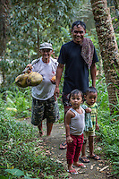Bali, Indonesia.  Hindu Balinese Children with father and Friend on a Forest Path.