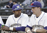 03 April 2009:  Washington's Caleb Brown (left) and Kyle Conley (right) chat in the dug out before the game against Arizona State at Safeco Field in Seattle, WA.  Arizona State won 3-1 over Washington.
