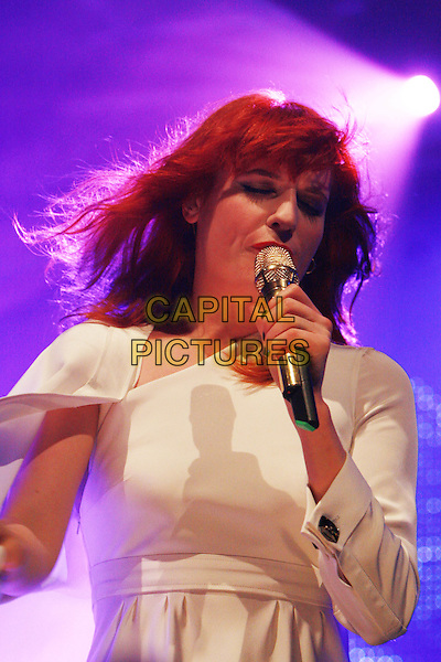 FLORENCE WELCH of FLORENCE AND THE MACHINE.Performs live during Radio One's Big Weekend, Bangor, North Wales, .UK, May 22nd 2010..1 1's music live on stage concert gig half length   white cream dress microphone  singing .CAP/MAR.© Martin Harris/Capital Pictures.