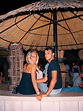 CROATIA, Bol, Brac, Dalmatian Coast, smiling young couple sitting together in Varadero club