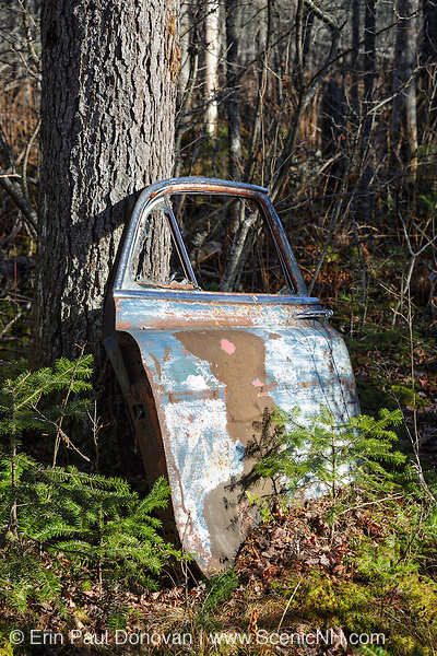 Remnants of a vehicle at the abandoned cabin settlement surrounding Elbow Pond in Woodstock, New Hampshire USA.