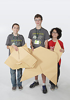 OrigamiUSA 2016 Convention at St. John's University, Queens, New York, USA. Oversized 9' x 9' paper folding event. First timers. Left to right: Spencer Grinsfelder, NY, Tony Koppers, NY, Avery Peng, WA.