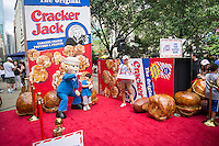 "A promotional event for the iconic Cracker Jack snack entitled ""The Surprise Inside Project"" is attended by crowds in Herald Square in New York on Thursday, June 26, 2014. PepsiCo, the owner of the brand within its Frito-Lay division, has started an advertising push for the snack using social media and targeting mothers in the 25 to 45 age range. (© Richard B. Levine)"