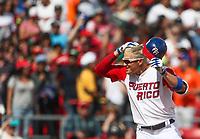 Kike Hernadez  de Puerto Rico luego de conectar un triple en la quinta entrada , durante el partido entre Italia vs Puerto Rico, World Baseball Classic en estadio Charros de Jalisco en Guadalajara, Mexico. Marzo 12, 2017. (AP Photo/Luis Gutierrez)