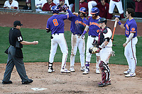 Shortstop Logan Davidson (8) of the Clemson Tigers is greeted after hitting a two-run home run in the eighth inning of the Reedy River Rivalry game against the South Carolina Gamecocks on Saturday, March 2, 2019, at Fluor Field at the West End in Greenville, South Carolina. Clemson won, 11-5. (Tom Priddy/Four Seam Images)