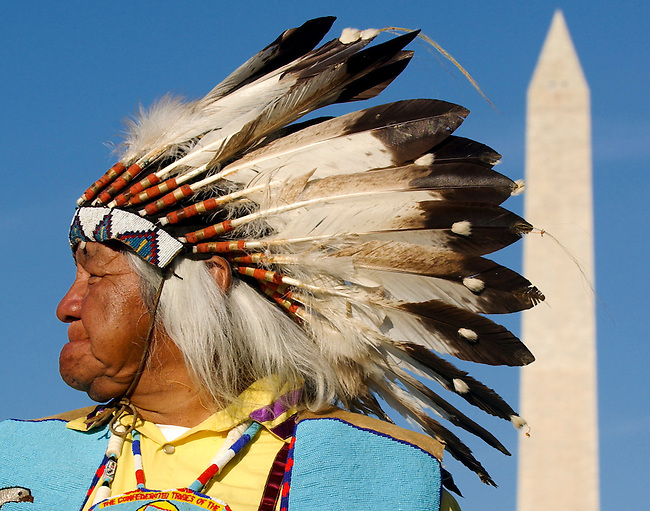 Chief Delvis Heath, Sr., of The Confederated Tribes of the Warm Springs Reservation of Oregon, waits to take part in the Native Nations Procession during the opening ceremonies for the Smithsonian's National Museum of the American Indian in Washington on Sept. 21, 2004.
