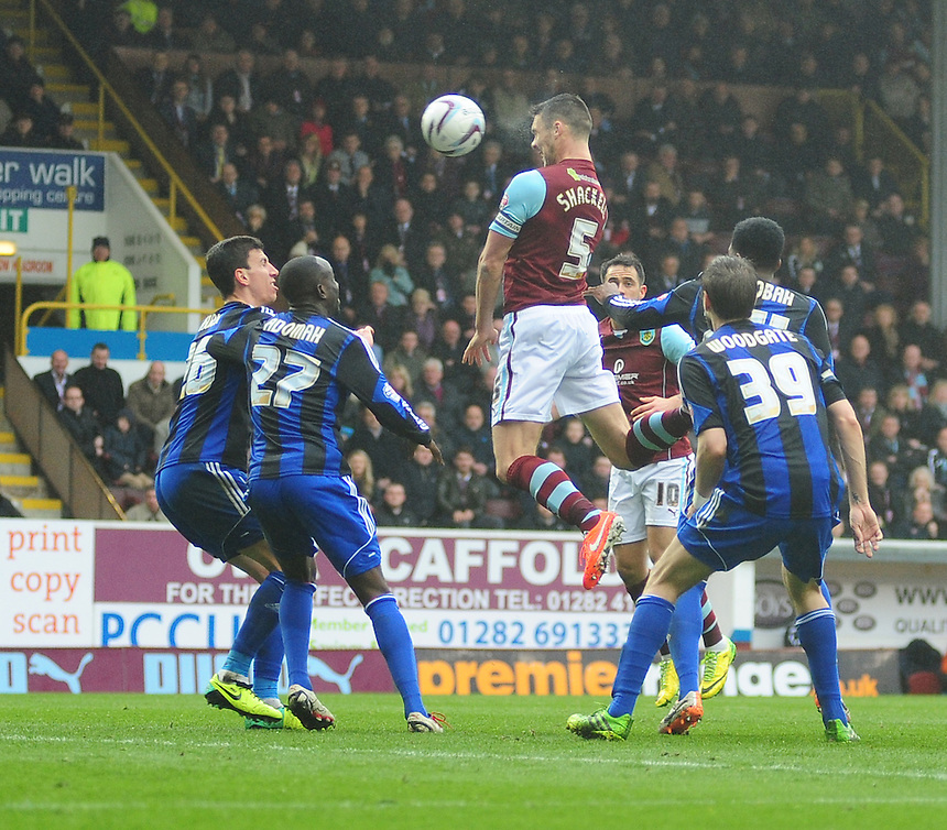 Burnley's Jason Shackell fails to hit the back of the net with a header<br /> <br /> Photo by Chris Vaughan/CameraSport<br /> <br /> Football - The Football League Sky Bet Championship - Burnley v Middlesbrough - Saturday 12th April 2014 - Turf Moor - Burnley<br /> <br /> &copy; CameraSport - 43 Linden Ave. Countesthorpe. Leicester. England. LE8 5PG - Tel: +44 (0) 116 277 4147 - admin@camerasport.com - www.camerasport.com