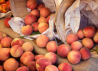 Peaches and baskets at a farmers market. Los Angeles, California