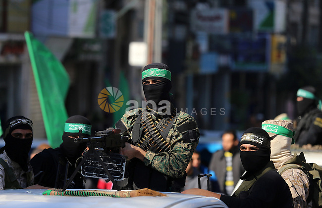 Palestinian Hamas militants attend the funeral of fellow of their comrade who was killed when a tunnel collapsed on Wednesday, during his funeral in Gaza City December 8, 2016. Photo by Yasser Qudih
