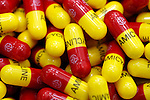 Numerous yellow and red Amicycline capsules. Royalty Free