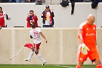 Thierry Henry (14) of the New York Red Bulls celebrates scoring as New England Revolution goalkeeper Matt Reis (1) walks back to the goal during the first half during a Major League Soccer (MLS) match at Red Bull Arena in Harrison, NJ, on April 28, 2012.