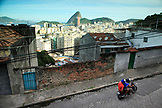 BRAZIL, Rio de Janiero, driving a motorbike through the streets of Favela Tavares Bastos