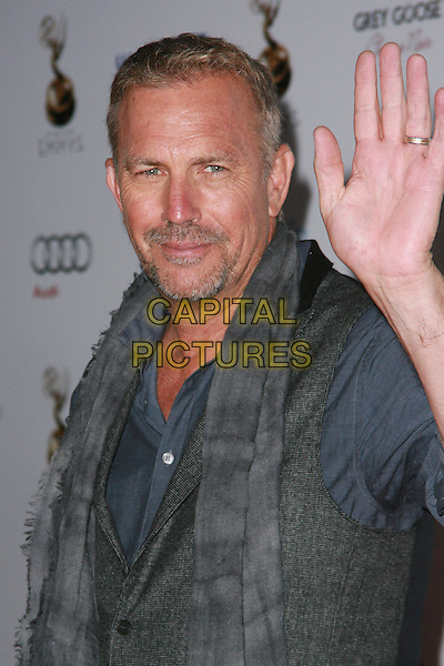 Kevin Costner, Christine Baumgartner.The Television Academy's 64th Primetime Emmy Awards Performers Nominee Reception held at Pacific Design Center, West Hollywood, California USA..21st September 2012 .emmys headshot portrait jacket hand arm waving palm goatee facial hair grey gray.CAP/ADM/KN.©KN/AdMedia/Capital Pictures.